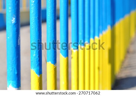 yellow blue metall fence - stock photo