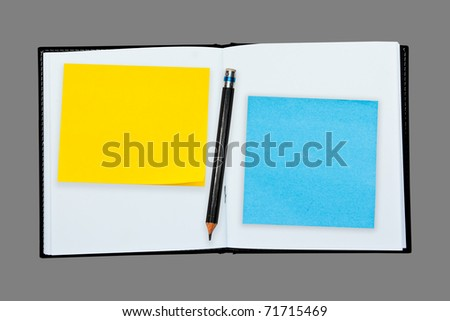 Yellow,Blue post it note with pencil on Blank notebook - stock photo
