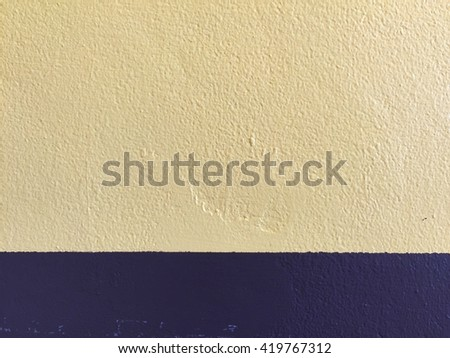 Yellow blue scratch cement wall background
