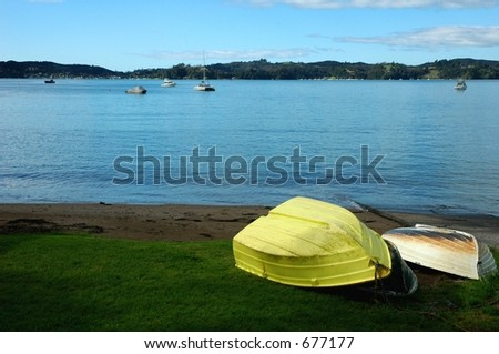 yellow boat at seaside - stock photo