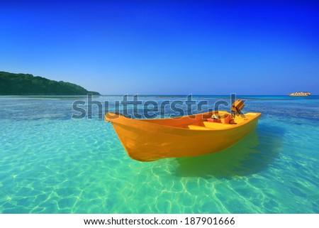 yellow boat on the beach  - stock photo
