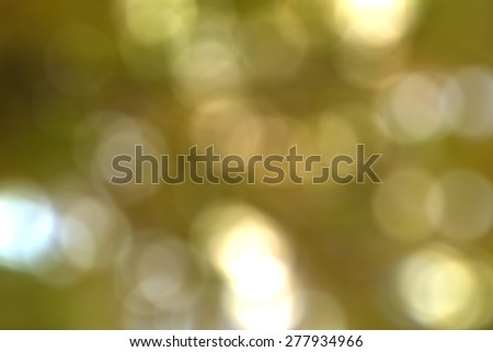 Yellow bokeh background with soft focus and colors - stock photo