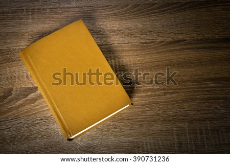 Yellow book on the table - stock photo