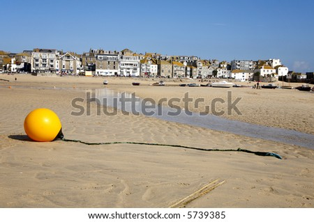 Yellow boy at low tide on St. Ives harbour beach. - stock photo