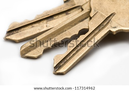 Yellow brass key on isolated white background. - stock photo