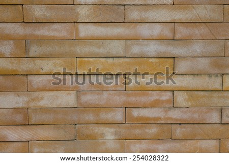 Yellow brick wall texture background