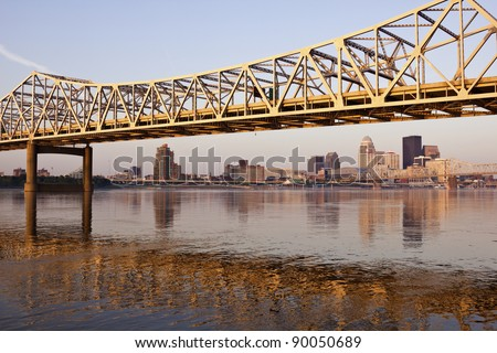 Yellow bridge in Louisville on Ohio River in Louisville, Kentucky - stock photo