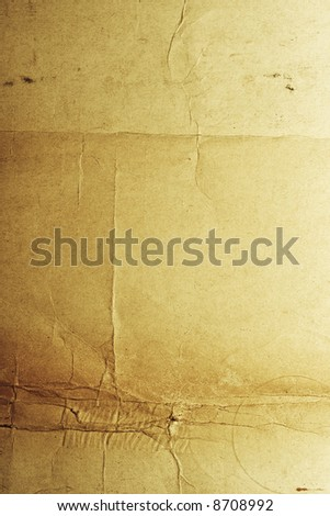 Yellow-brown messy rough old paper with cracks and folds - stock photo