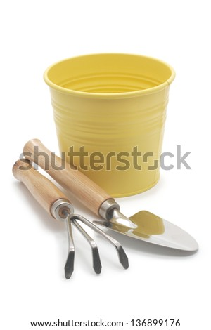 Yellow bucket with garden tools.