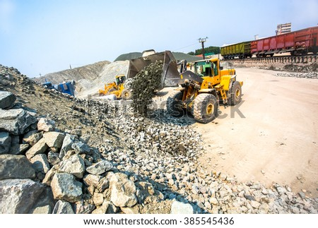 Yellow bulldozer working in quarry