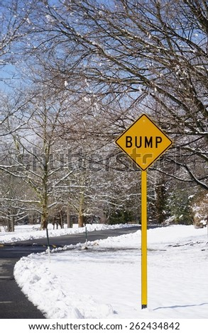 Yellow bump road sign in a snowy landscape