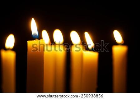 yellow burning candles - stock photo
