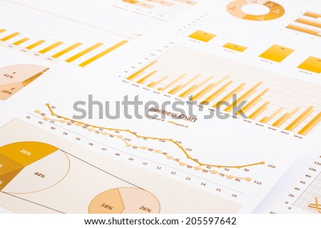 yellow business charts, graphs, reports and summarizing background,  management and project for business concepts - stock photo
