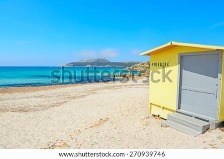 yellow cabin by the shore in Santa Reparata beach, Sardinia - stock photo