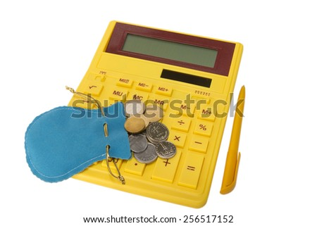 yellow calculator with coins and yellow handle - stock photo