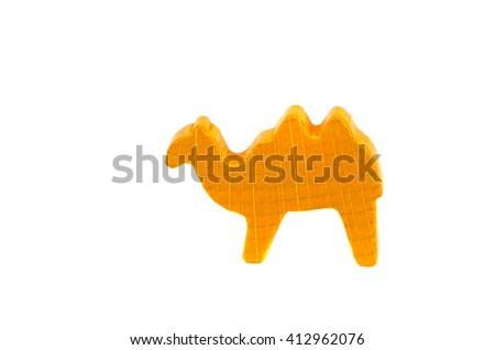 Yellow camel figurine isolated on white - stock photo