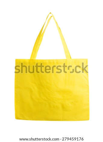 Yellow canvas shopping bag. Isolated on a white background. - stock photo