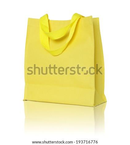 yellow canvas shopping bag on white background - stock photo