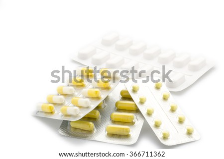 Yellow capsules pill blister pack - stock photo