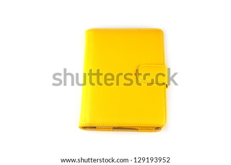 Yellow case for tablet on white background. - stock photo