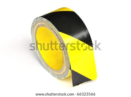 Yellow caution tape on white background - stock photo