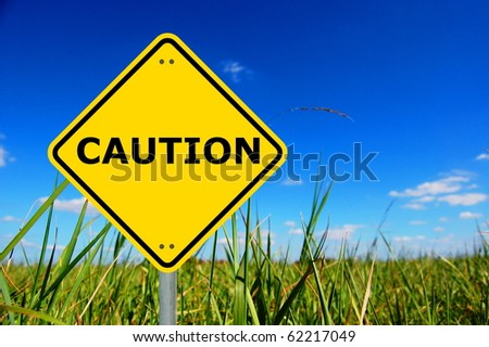 yellow caution traffic sign with copyspace for text message - stock photo