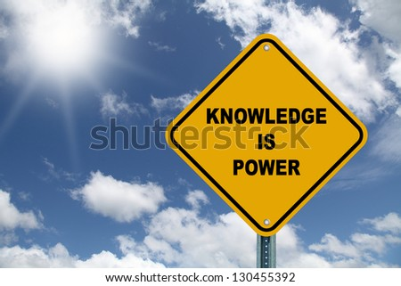 Yellow cautionary road sign Knowledge is Power - stock photo
