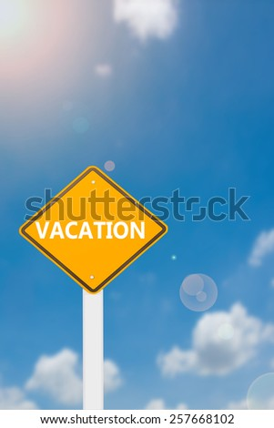 yellow cautionary road sign vacation against a beautiful sky background - stock photo