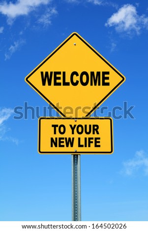 Yellow cautionary road sign Welcome to your new life - stock photo