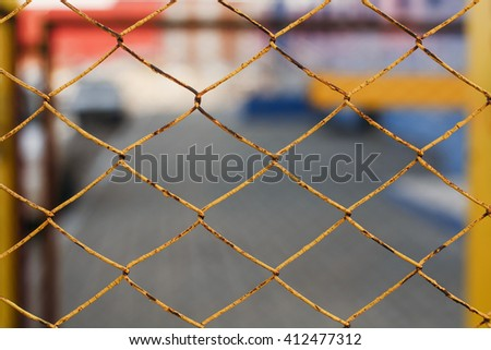 Yellow chain-link fencing. - stock photo