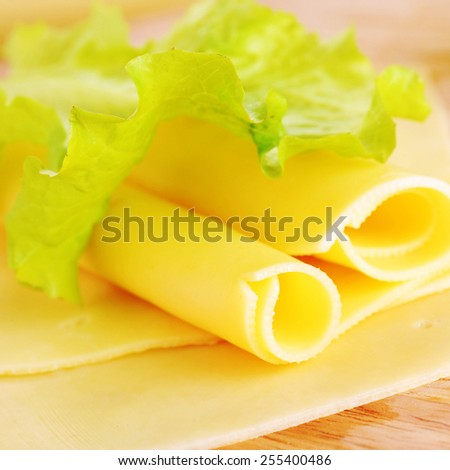yellow cheese on green leaf