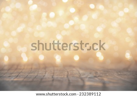 Yellow Christmas lights background with wooden floor - stock photo