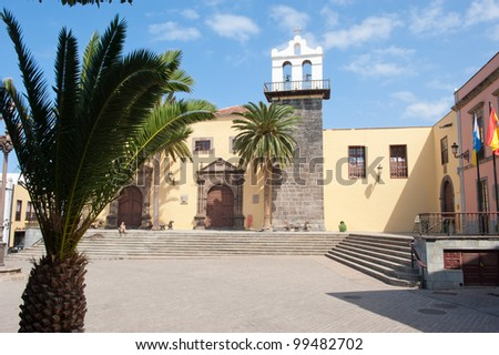 Yellow church with a square in front of it on Tenerife one on the Canary Islands