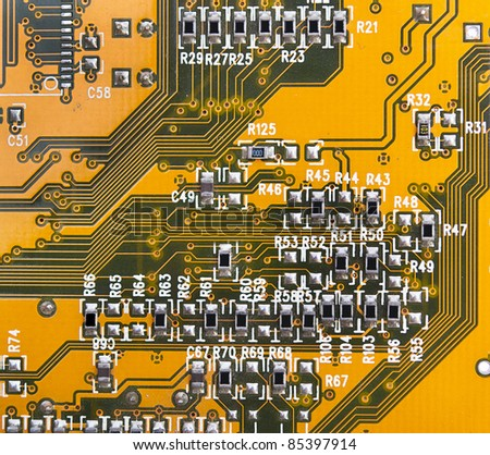 yellow circuit board with components. - stock photo