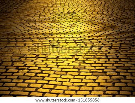 yellow cobblestone road - stock photo