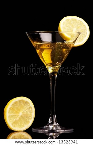 Yellow cocktail  with lemon on black background