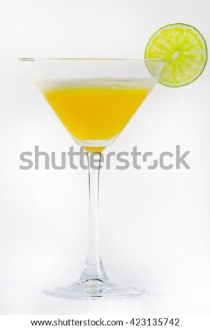 yellow cocktail with lemon slice. Martini cocktail on white background.
