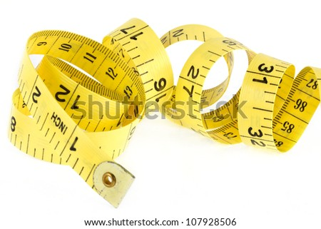 Yellow coiled tape measure on a white background - stock photo