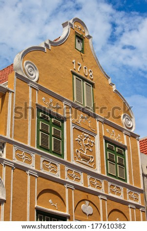 Yellow colonial house in Willemstad, Capital of Curacao in the Caribbean. Downtown Willemstad is a UNESCO World Heritage Site. - stock photo