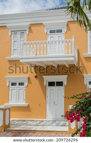 Yellow colonial style house in Willemstad, Curacao. - stock photo