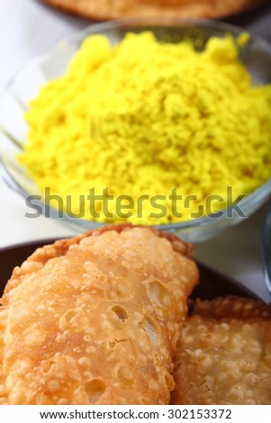 yellow color in focus and rest color blur, gujia snacks - stock photo