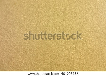 Yellow color paint on concrete wall:Close up,select focus with shallow depth of field:Macro shot - stock photo