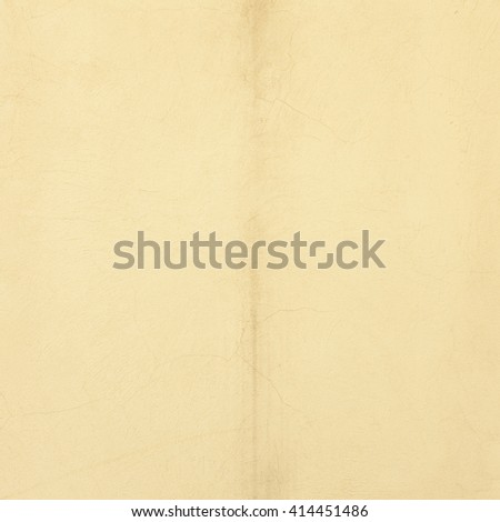 Yellow concrete wall like an open book, abstract texture background. Free copy space