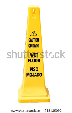 Yellow cone cautioning for wet floor in english and spanish isolated on white - stock photo