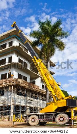 yellow construction crane for heavy lifting - stock photo