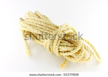 Yellow construction hemp rope on the white background