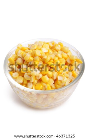 Yellow corn grain in plate (isolated, close up) - stock photo