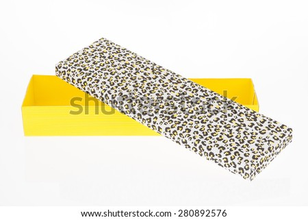 yellow corrugated cardboard box with lid for packing gifts and presents - stock photo