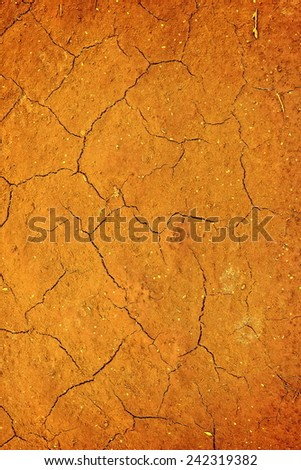 yellow cracked earth - stock photo