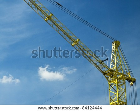 Yellow crane at the blue sky